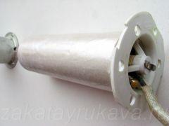 Нагревательный элемент фена Интерскол ФЭ-2000. Металлический кожух снят. Сверху - оболочка из слюды.