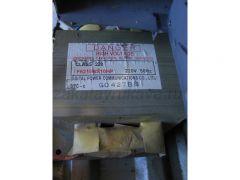Высоковольтный трансформатор микроволновой печи. Вид на шильдик.
