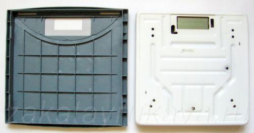 Разборка электронных весов MARTA MT-1650. Снятие декоративной пластмассовой крышки.